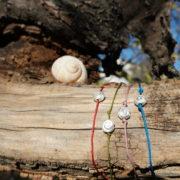 Wiener Schnecken-Bändchen in verschiedenen Farben von Gugumuck. Schecken Sie Ihren Liebsten ein Schneckenarmband aus 925 Sterling Silber mit einem Bändchen in verschiedenen Farben. Ein ideales Schmuck Geschenk.