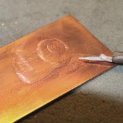 Stich Schnecke, Kupferstich einer Escargot für die Schneckenfarm Gugumuck, Übung und Perfektion, Geduld, nicht schnell